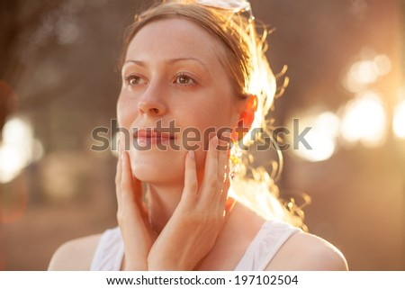 Young woman portrait at sunset background. - stock photo