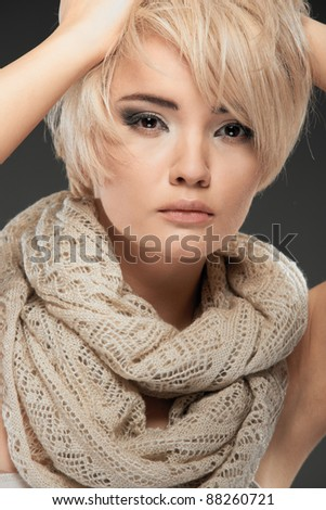 Young woman portrait. Closeup beauty studio shoot. Healthy clean skin and perfect makeup on beautiful face of white model with short blonde hair. Beautiful girl - stock photo
