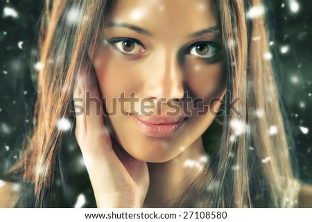 Young woman portrait. Falling flakes effect. - stock photo