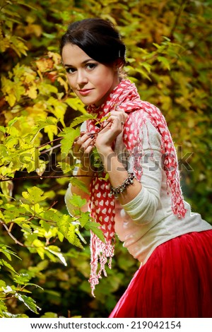 Young woman portrait in autumn park.Young woman in beautiful autumn park, concept autumn.Autumn woman on leafs background