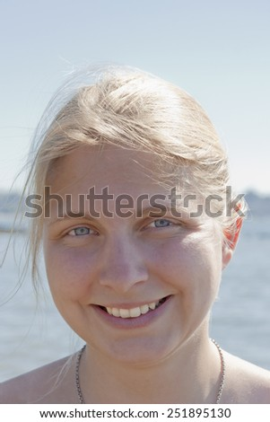 Young Woman Portrait in front of Sea - Stanley Park, Vancouver, Canada - stock photo