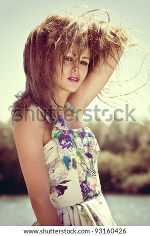 young woman portrait on a hot summer day afternoon - stock photo