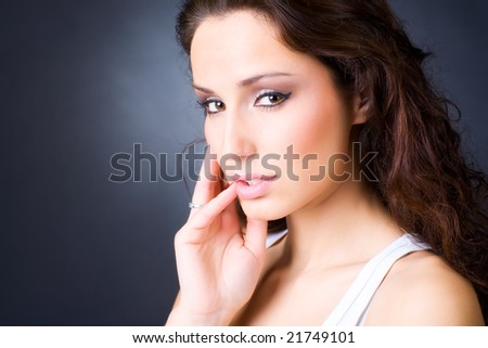 Young woman portrait. On dark background. - stock photo
