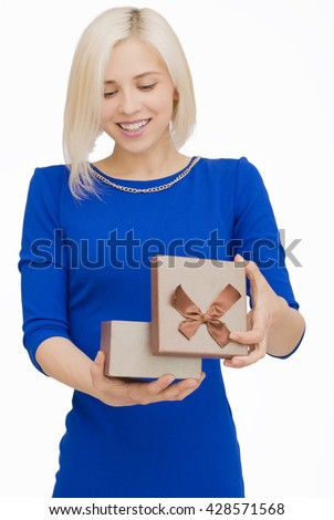 Young woman portrait opening gift