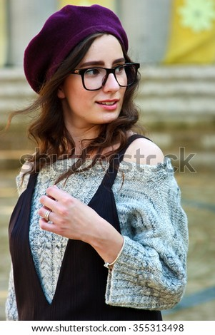 Young woman portrait smiling outdoors on the street - stock photo