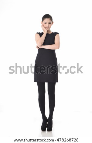 Young woman portrait standing and wearing a black dress