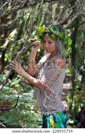 young woman portrait wearing wreath in summer - stock photo