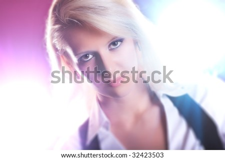 Young woman portrait with bright flashes. - stock photo