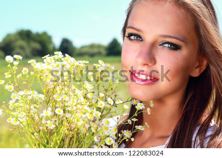 Young woman portrait with chamomile bouquet - stock photo