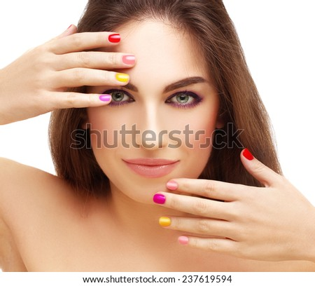 Young woman portrait with colorful makeup and nail polish - stock photo