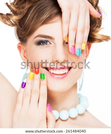 Young woman portrait with colorful makeup and nail polish, manicure, studio shot - stock photo