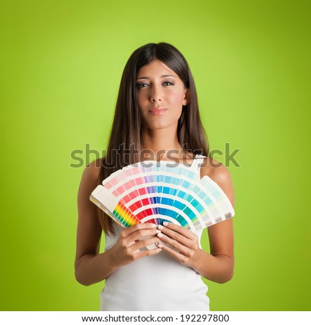 Young woman portrait with colors palette against colorful green background.  - stock photo