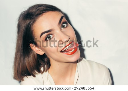Young woman portrait with dental braces natural - stock photo