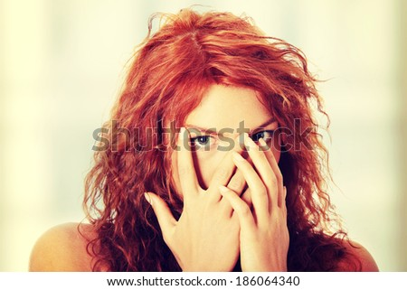 Young woman portrait - with face expression - scared - stock photo