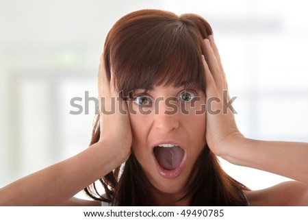 Young woman portrait - with face expression - scared