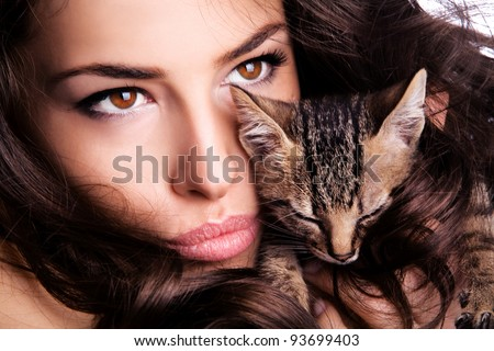young woman portrait with kitten - stock photo