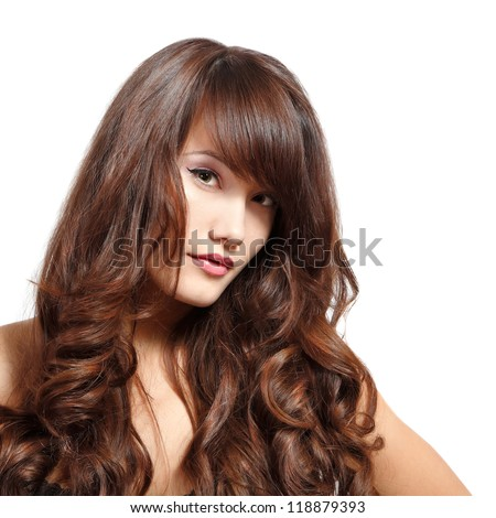 young woman portrait with long hair looking at camera, studio shot