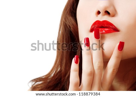 young woman portrait with long hair, red lipstick and manicure, studio shot - stock photo