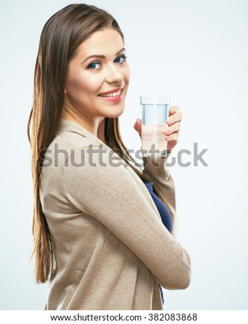 Young woman portrait with water glass. White background isolated. - stock photo