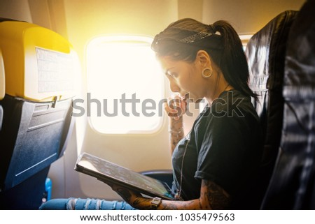 Charming Young Woman Portrait Working With Tablet Inside Airplane. Natural Flare  From The Window. Life