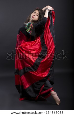 Young woman pose on camera in spanish clothes