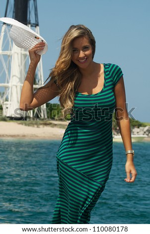 Young woman poses near a lighthouse in Florida - stock photo