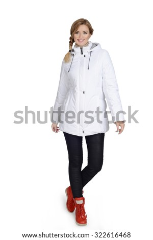 Young woman posing at studio in short coat