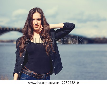 Young woman posing in city quay