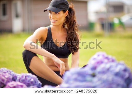 Young woman posing in fitness outfit. - stock photo