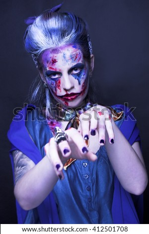 Young woman posing in spooky image of zombie-girl. - stock photo