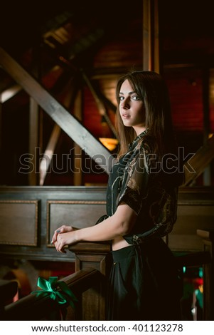 Young woman posing in vintage interior.