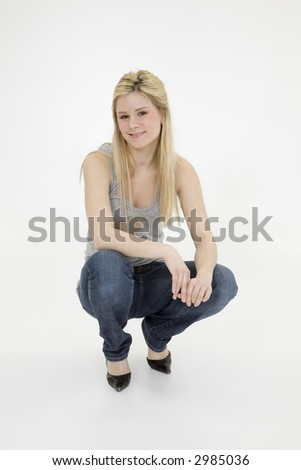 Young woman posing on white background with some attitude - stock photo