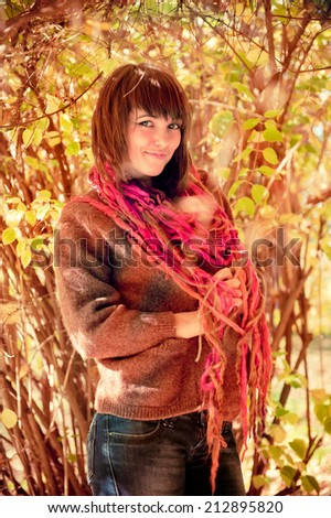 Young woman posing outdoor in autumn park.  - stock photo
