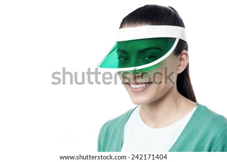 Young woman posing to camera wearing her new cap - stock photo