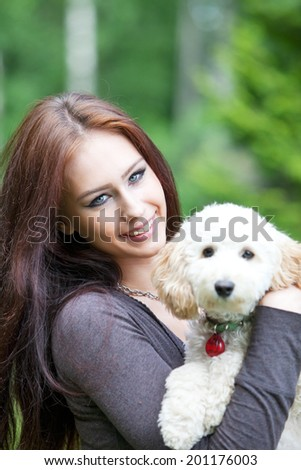 Young woman posing with a dog