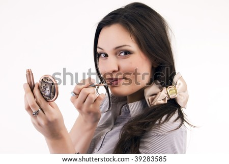 Young woman: posing with makeup tool