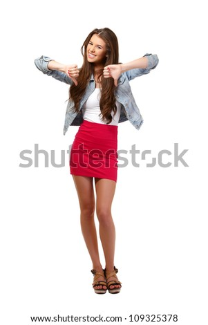 young woman posing with thumbs down - stock photo