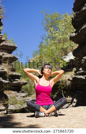 Young woman practice in nature - stock photo