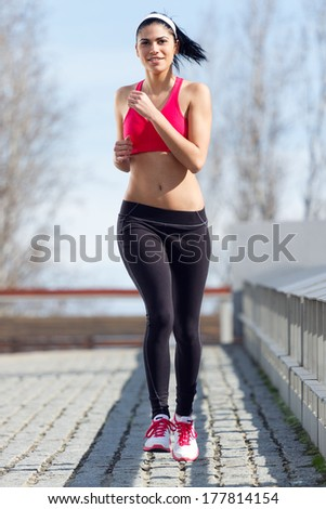 Young woman practicing exercise in the city