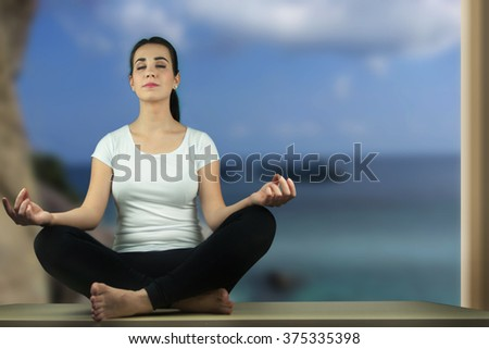 Young woman practicing meditation in nature.
