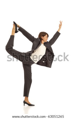 Young woman practicing yoga in a business suit - stock photo