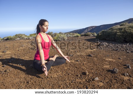 young woman practicing yoga meditation outdoors - stock photo