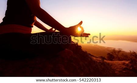 Young woman practicing yoga(yoga lotus meditation).
