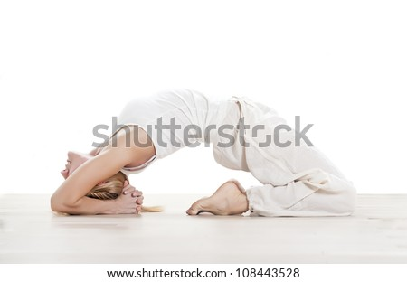 young woman practising yoga exercise - stock photo