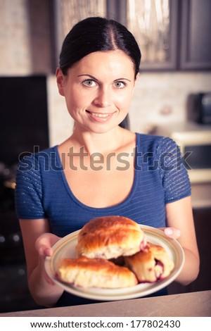 young woman prepared cherry pies, bon appetit - stock photo