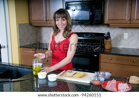 Young woman prepares sandwiches