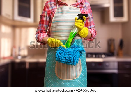 Young woman preparing to clean the kitchen - stock photo