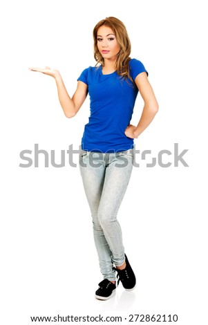 Young woman presenting a product on empty palm. - stock photo