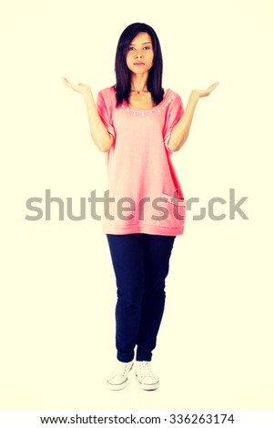Young woman presenting copy space on her palm. - stock photo