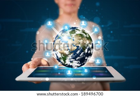 Young woman presenting 3d earth globe in modern tablet - stock photo